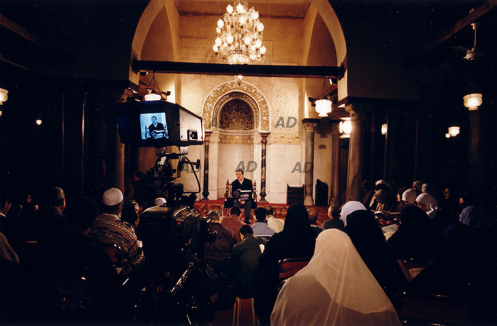 Imam read Koran on TV.