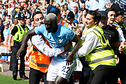Benjamin Mendy (22) of Manchester City is pulled away from the goal celebrations in the crowd after Raheem Sterling (7) of Manchester City scored the winning goal to make the score 2-1 to city during the Premier League match between Bournemouth and Manchester City at the Vitality Stadium, Bournemouth, England on 26 August 2017. Photo by Graham Hunt.