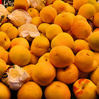 Yellow-skinned Peaches at La Boqueria Market in Barcelona, Spain<br />