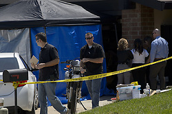 April 25, 2018 - Citrus Heights, California, U.S. - Law enforcement authorities process evidence at the home of suspected ''East Area Rapist'' at his home in Citrus Heights. A suspect has been arrested in the case of the a serial killer who investigators believe raped 45 women and murdered 12 people in the Sacramento region 1970s and 1980s, known as the East Area Rapist or Golden State Killer. Sacramento County booked 73 year old Joseph James DeAngelo early Wednesday morning on two counts of murder, according to jail records. DeAngelo was wanted on a Ventura County arrest warrant and is being held without bail. The FBI had previously released these sketches of the suspect known as the East Area Rapist and Golden State Killer. (Credit Image: © Randall Benton/Sacramento Bee via ZUMA Wire)