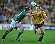 James O'Connor drops the ball under the pressure of Tommy Bowe's tackle during action from the Rugby Union Test Match played between Australia and Ireland at Suncorp Stadium (Brisbane) on Saturday 26th June 2010 ~ Australia (22) defeated Ireland (15) ~ © Image Aura Images.com.au ~ Conditions of Use: This image is intended for Editorial use as news and commentry in print, electronic and online media ~ Required Image Credit : Steven Hight (AURA Images)For any alternative use please contact AURA Images