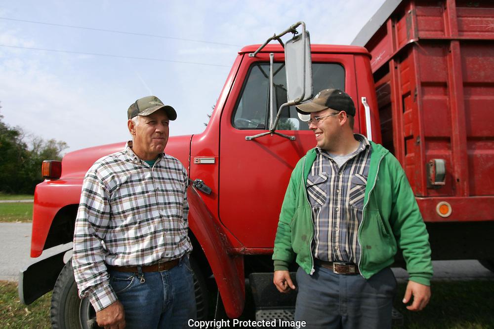 Dan Adams and Ryan Miller harvesting corn in Portage, Ohio.