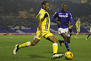 Millwall's Shaun Cummings clears under pressure from Birmingham's Lloyd Dyer during the Sky Bet Championship match between Birmingham City and Millwall at St Andrews, Birmingham, England on 10 February 2015. Photo by Shane Healey.