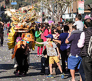 Parade goers interact with lion dancers during the 119th annual Chinese New Year &quot;Golden Dragon Parade&quot; in the streets of Chinatown in Los Angeles, Feburary 17, 2018. (Photo by Ringo Chiu)<br /> <br /> Usage Notes: This content is intended for editorial use only. For other uses, additional clearances may be required.