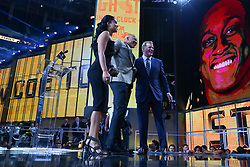 April 26, 2018 - Arlington, TX, U.S. - ARLINGTON, TX - APRIL 26: Ryan Shazier,  Michelle Rodriguez and NFL Commissioner Roger Goodell stand waiting for the Pittsburgh Steelers 28th pick during the first round at the 2018 NFL Draft at AT&T Statium on April 26, 2018 at AT&T Stadium in Arlington Texas.  (Photo by Rich Graessle/Icon Sportswire) (Credit Image: © Rich Graessle/Icon SMI via ZUMA Press)