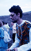 Raver in sunglasses at the first outdoor rave up North, The Gio Goi Joy Rave run by Anthony and Chris Donnelly, Ashworth Valley, Rochdale, 5th August 1989.