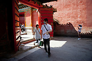 "Young couple entering ""The Forbidden City"" which was the Chinese imperial palace from the Ming Dynasty to the end of the Qing Dynasty. It is located in the middle of Beijing, China. Beijing is the capital of the People's Republic of China and one of the most populous cities in the world with a population of 19,612,368 as of 2010."