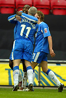 Photo: Chris Brunskill. Wigan Athletic v Millwall. Coca-Cola Championship. 12/03/2005. Jason Roberts of Wigan is congratulated by teammate Graham Kavanagh after scoring the second goal of the game.