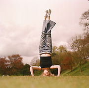 Girl doing a hand-stand on the field at Cardiff 2000's