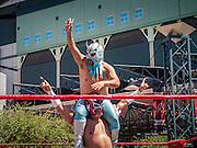 16 SEPTEMBER 2012 - PHOENIX, AZ:  A Lucha Libre tag team celebrate their victory during a Lucha Libre exhibition match on Hispanic Heritage Day in Phoenix. The Arizona Diamondbacks hosted their 14th Annual Hispanic Heritage Day, Sunday to kick off Hispanic Heritage Month (Sept. 15-Oct. 15) before the 1:10 p.m. game between the D-backs and San Francisco Giants. The main attraction of the Day was three Lucha Libre USA exhibition wrestling matches in front of Chase Field stadium before the game.    PHOTO BY JACK KURTZ