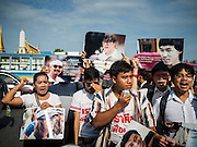 07 JULY 2015 - BANGKOK, THAILAND:  Student activist  SIRIWIT SERITHIWAT (with microphone) leads a group of democracy advocates to the Ministry of Defense before a rally at the MoD. About 100 people gathered in front of the Ministry of Defense in Bangkok Tuesday to support 14 university students arrested two weeks ago for violating orders against political assembly. They're facing criminal trial in military courts. The courts ordered their release Tuesday because they can only be held for two weeks without trial, the two weeks expired Tuesday and the military court chose not to renew their pretrial detention. The court order was not an acquittal. They still face trial and possible prison sentences if convicted.       PHOTO BY JACK KURTZ