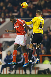 Michail Antonio of Nottingham Forest and Harlee Dean of Brentford compete in the air - Photo mandatory by-line: Rogan Thomson/JMP - 07966 386802 - 05/11/2014 - SPORT - FOOTBALL - Nottingham, England - City Ground - Nottingham Forest v Brentford - Sky Bet Championship.