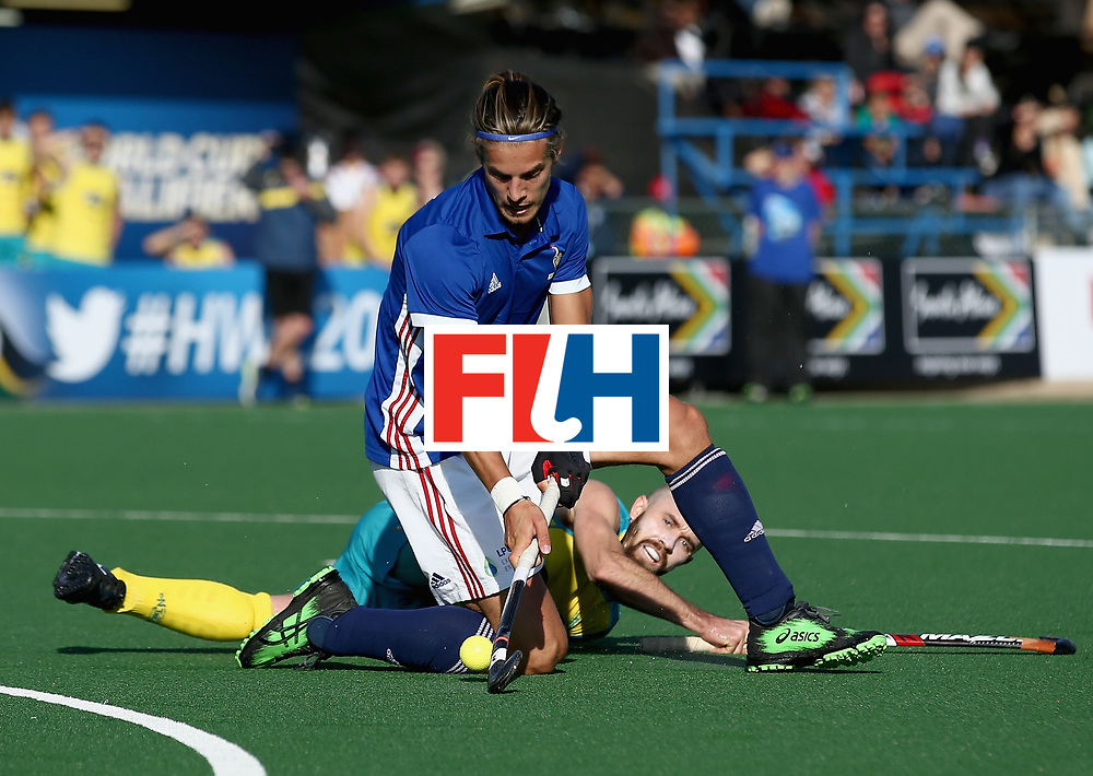 JOHANNESBURG, SOUTH AFRICA - JULY 11: Nicolas Dumont of France and Matthew Swann of Australia battle for possession during day 2 of the FIH Hockey World League Semi Finals Pool A match between Australia and France at Wits University on July 11, 2017 in Johannesburg, South Africa. (Photo by Jan Kruger/Getty Images for FIH)