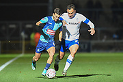 Wycombe Wanderers striker Scott Kashket (11) battles for possession  with Tranmere Rovers defender (on loan from West Bromwich Albion) Kane Wilson (22)during the The FA Cup match between Wycombe Wanderers and Tranmere Rovers at Adams Park, High Wycombe, England on 20 November 2019.