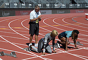 LSU Tigers coach Dennis Shaver  (back) supervises block starts with Sha'Carri Richardson (left) and Aleia  Hobbs at a training session  prior to the 45th Prefontaine Classic, Saturday, June 29, 2019, in Stanford,  Calif.