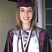 Portrait of National Honor Society student dressed in cap and gown for high school graduation photo in Orlando Florida