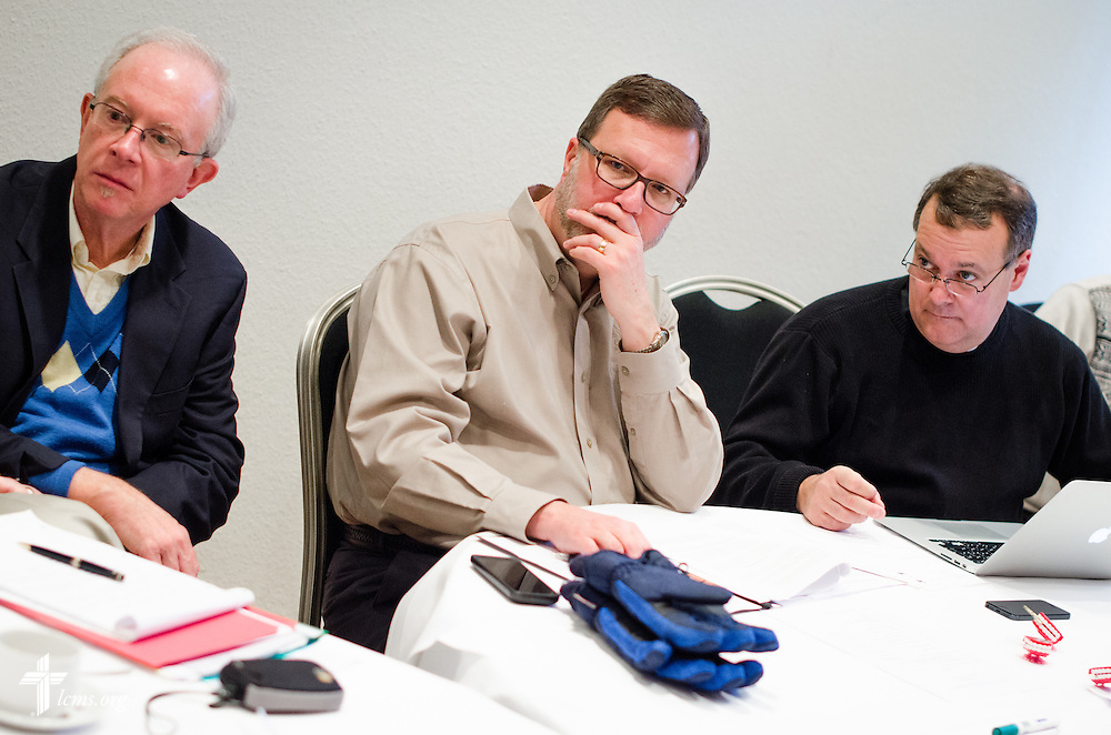 Dr. Bruce Kintz, president and CEO of Concordia Publishing House (center),  the Rev. David Mahsman (left), LCMS missionary and the ILSW's managing director, and Dr. Lawrence R. Rast Jr, the president at Concordia Theological Seminary, listen during a meeting at the Luther Hotel on Wednesday, Jan. 29, 2014, in Wittenberg, Germany. LCMS Communications/Erik M. Lunsford