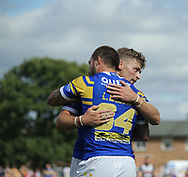 Luke Briscoe (L) of Leeds Rhinos celebrates scoring his try with team mate Jimmy Keinhorst (R) against London Broncos during the Super 8s Qualifiers match at Trailfinders Sports Club, Ealing<br /> Picture by Stephen Gaunt/Focus Images Ltd +447904 833202<br /> 19/08/2018