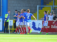 Josh Gillies of Carlisle United (left) is congratulated by team-mates after scoring his team's third goal during the Sky Bet League 2 match at Brunton Park, Carlisle<br /> Picture by Greg Kwasnik/Focus Images Ltd +44 7902 021456<br /> 06/09/2014