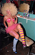 A girl wearing a blond afro wig, Garlands, Liverpool, UK, 2002