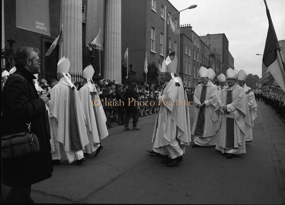 Episcopal Ordination Of Desmond Connell. (R74).1988..06.03.1988..03.06.1988..6th March 1988..Following the death of Archbishop Kevin McNamara in April '87, Pope John Paul II surprisingly nominated Desmond Connell for the position of Archbishop of Dublin. The ordination of Dr Connell took place at the Pro-Cathedral in Dublin...Image shows the Heirarchy in ceremonial robes as they enter the Pro-Cathedral for the Episcopal Ordination.