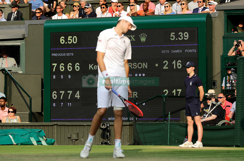 John Isner reacts on day eleven of the Wimbledon Championships at the All England Lawn Tennis and Croquet Club, Wimbledon. PRESS ASSOCIATION Photo. Picture date: Friday July 13, 2018. See PA story TENNIS Wimbledon. Photo credit should read: Ben Curtis/PA Wire. RESTRICTIONS: Editorial use only. No commercial use without prior written consent of the AELTC. Still image use only - no moving images to emulate broadcast. No superimposing or removal of sponsor/ad logos. Call +44 (0)1158 447447 for further information.