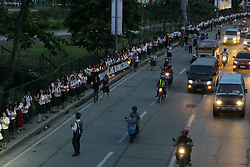 September 21, 2016 - Quezon, National Capital Region, Philippines - Students march along the street of Katipunan Avenue..Miriam College held a Eucharistic Mass in memory of the people who died during the war on drugs. Candles are light up in their memory and a march to Katipunan Avenue to a pedestrian overpass. This is also in celebration of International Day of Peace by the students and faculty of Miriam College with a theme ''Mahalaga ang Buhay' (Credit Image: © George Buid/Pacific Press via ZUMA Wire)