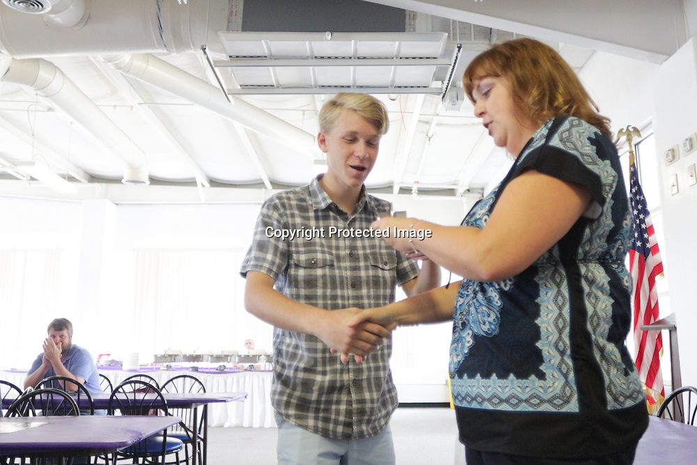 August Mills accepts an award from Star News Editor Sherry Jones for the 15 Under 15 project Sunday September 14, 2014 at Jungle Rapids in Wilmington, N.C. (Jason A. Frizzelle)