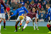 Glen Kamara (#18) of Rangers FC and Jamie Walker (#10) of Heart of Midlothian FC fight for the ball during the Ladbrokes Scottish Premiership match between Rangers FC and Heart of Midlothian FC at Ibrox Park, Glasgow, Scotland on 1 December 2019.