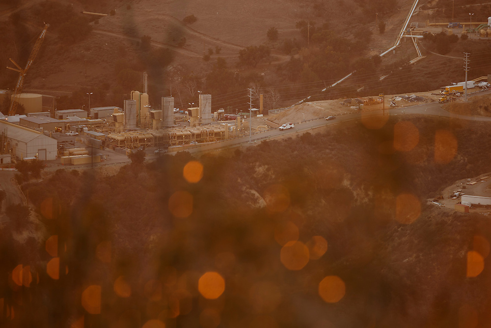 Vehicles drive past machinery at the SoCalGas Aliso Canyon Storage Facility at sunset as seen from the top of a public hiking trail from Bee Canyon Park as methane gas leaks from the SoCalGas Aliso Canyon Storage Facility well SS-25 in the Porter Ranch neighborhood of Los Angeles, California on Wednesday, December 30, 2015. The Aliso Canyon gas leak (also called Porter Ranch gas leak) was a massive natural gas leak that started on October 23, 2015. According to Wikipedia, an estimated 1,000,000 barrels per day was released from a well within the underground storage facility in the Santa Susana Mountains near Porter Ranch. The second-largest gas storage facility it belongs to the Southern California Gas Company (SoCalGas), a subsidiary of Sempra Energy. On Jan. 6, 2016, Governor Jerry Brown issued a State of Emergency. The Aliso gas leak carbon footprint is said to be larger than the Deepwater Horizon leak in the Gulf of Mexico. On Feb. 11, 2016 the gas company reported that it had the leak under control. On Feb. 18 state officials announced that the leak was permanently plugged. An estimated 97,100 tonnes of methane and 7,300 tonnes of ethane was released into the atmosphere, making it the worst natural gas leak in U.S. history in terms of its environmental impact. © 2015 Patrick T. Fallon