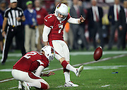 Arizona Cardinals punter Drew Butler (2) holds while Arizona Cardinals kicker Chandler Catanzaro (7) kicks a 28 yard third quarter field goal that cuts the Green Bay Packers lead to 13-10 during the NFL NFC Divisional round playoff football game against the Green Bay Packers on Saturday, Jan. 16, 2016 in Glendale, Ariz. The Cardinals won the game in overtime 26-20. (©Paul Anthony Spinelli)