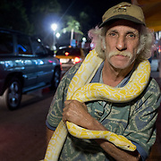 MIAMI BEACH, FLORIDA, NOVEMBER 4, 2016<br /> Samuel Plut, 77, with his pet snake Manaus, in Miami Beach's popular Ocean Drive on a Friday night. Recent incidents of violence and crime are pushing the city of Miami Beach to try to alter the appeal of the area.<br /> (Photo by Angel Valentin/Freelance)