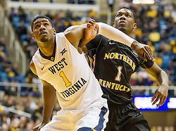 Nov 13, 2015; Morgantown, WV, USA; West Virginia Mountaineers forward Jonathan Holton and Northern Kentucky Norse forward Jordan Garnett box out during a shot during the first half at WVU Coliseum. Mandatory Credit: Ben Queen-USA TODAY Sports
