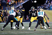 Jacksonville Jaguars defensive end Calais Campbell (93) and Jacksonville Jaguars defensive end Yannick Ngakoue (91) rush against the Pittsburgh Steelers offensive line during the NFL 2018 AFC Divisional playoff football game against the Pittsburgh Steelers, Sunday, Jan. 14, 2018 in Pittsburgh. The Jaguars won the game 45-42. (©Paul Anthony Spinelli)