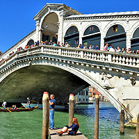 Rialto Bridge in Venice, Italy <br /> In 1591, a wooden bridge that repeatedly collapsed was replaced by the Rialto Bridge. This white stone treasure of Venice is located at roughly the midpoint of the Grand Canal. For three hundred years, it served as the only foot bridge across the city's main waterway. Notice the portico containing merchant shops. Interestingly, a design for this bridge by Michelangelo was rejected.