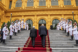 February 27, 2019 - Hanoi, Vietnam - Vietnamese President NGUYEN PHU TRONG escorts U.S President DONALD TRUMP on arrival past honor guards at the Presidential Palace in Hanoi, Vietnam. (Credit Image: © Shealah Craighead/The White House via ZUMA Wire)