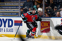KELOWNA, BC - SEPTEMBER 28: Jake Lee #21 of the Kelowna Rockets loses his stick as he checks Max Patterson #12 of the Everett Silvertips at the boards at Prospera Place on September 28, 2019 in Kelowna, Canada. (Photo by Marissa Baecker/Shoot the Breeze)
