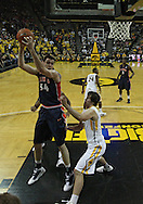 December 29 2010: Illinois Fighting Illini center Mike Tisdale (54) pulls down a rebound as Iowa Hawkeyes forward Zach McCabe (15) defends during the first half of an NCAA college basketball game at Carver-Hawkeye Arena in Iowa City, Iowa on December 29, 2010. Illinois defeated Iowa 87-77.