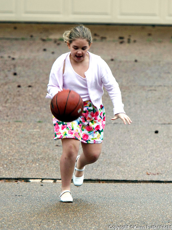 Elli Rose Focht plays basketball in a skirt.