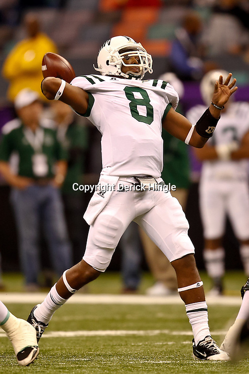 December 18, 2010; New Orleans, LA, USA; Ohio Bobcats quarterback Boo Jackson (8) throws a touchdown pass during the first half of the 2010 New Orleans Bowl against the Troy Trojans at the Louisiana Superdome.  Mandatory Credit: Derick E. Hingle