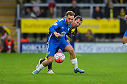 Peterborough United midfielder Erhun Oztumer uses hsi strength during the The FA Cup match between Burton Albion and Peterborough United at the Pirelli Stadium, Burton upon Trent, England on 7 November 2015. Photo by Aaron Lupton.