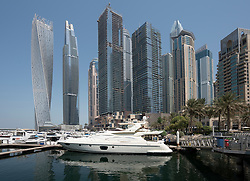 Many high rise apartment towers and skyscrapers in Marina district of Dubai, UAE, United Arab Emirates.
