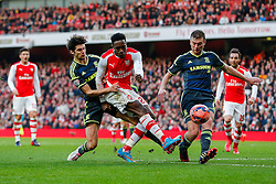 Danny Welbeck of Arsenal is challenged by Ryan Fredericks and Ben Gibson  of Middlesbrough - Photo mandatory by-line: Rogan Thomson/JMP - 07966 386802 - 15/02/2015 - SPORT - FOOTBALL - London, England - Emirates Stadium - Arsenal v Middlesbrough - FA Cup Fifth Round Proper.