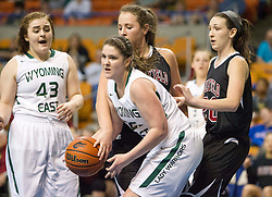 Wyoming East forward Brianne Pertee (25) tries to get out of traffic against Bluefield during a first round game at the Charleston Civic Center.