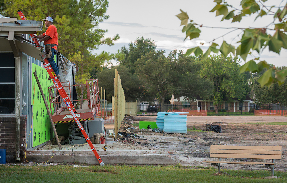 A contractor works on Parker Elementary School, August 19, 2015.