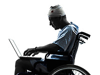 one injured man in wheelchair in silhouette studio on white background