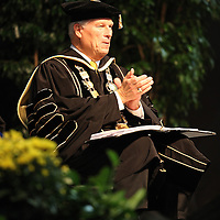 UCF President John Hitt watches as Bill Clinton addresses graduates of UCF's College of Health and Public Affairs and the College of Medicine's Burnett School of Biomedical Sciences at the UCF Arena on Thursday, May 2, 2013 in Orlando, Florida.   (AP Photo/Alex Menendez)