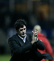 Photo: Marc Atkins.<br />Luton Town v Preston North End. Coca Cola Championship. 02/12/2006. Luton Manager Mike Newell applauds the fans after his sides 2-0 win over Preston.
