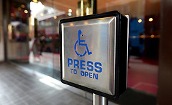 Embargoed to 0001 Friday June 23 File photo dated 15/09/14 of a disabled entrance door button. Ministers have been urged not to drop a Conservative manifesto pledge to get a million more disabled people into work.