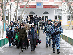 61009942<br /> Police escort children out of a school in northeast Moscow, where a high-school student took fellow pupils hostage and shot a teacher and a police officer dead. The teenager has been detained, Moscow, Russia, Monday, 3rd February 2014. Picture by  imago / i-Images<br /> UK ONLY